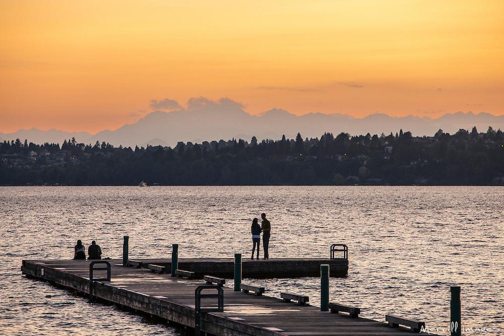 North America, United States, Washington, Kirkland, couple on dock on Lake Washington at sunset