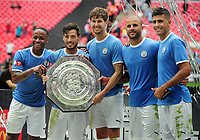 Football - 2019 FA Community Shield - Liverpool vs. Manchester City<br /> <br /> l-r : Raheem Sterling, David Silva, John Stones, Kyle Walker and Rodrigo of Man City with the Community Shield, at Wembley Stadium.<br /> <br /> COLORSPORT/ANDREW COWIE