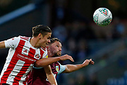 Luke O'Nien of Sunderland  and Kevin Long of Burnley  contest an aerial ball  during the EFL Cup match between Burnley and Sunderland at Turf Moor, Burnley, England on 28 August 2019.