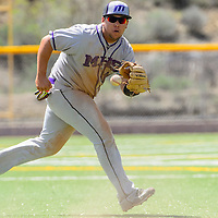 050215  Adron Gardner/Independent<br /> <br /> Miyamura Patriot William McKinley (18) gets in front of a Gallup Bengal infield ball at Ford Canyon Park in Gallup Saturday.