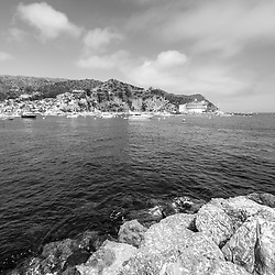 Catalina Island Avalon Harbor black and white photo with the Catalina Casino and breakwall rocks. Beautiful Santa Catalina Island is a popular travel destination off the Southern California coast. Photo is high resolution. Copyright ⓒ 2017 Paul Velgos with All Rights Reserved.