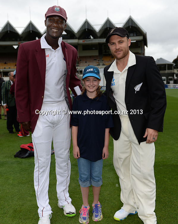 Captains Brendon McCullum and Darren Sammy and the ANZ Coin toss winner on Day 1 of the 2nd cricket test match of the ANZ Test Series. New Zealand Black Caps v West Indies at The Basin Reserve in Wellington. Wednesday 11 December 2013. Mandatory Photo Credit: Andrew Cornaga www.Photosport.co.nz