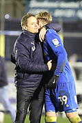 AFC Wimbledon manager Neal Ardley hugging AFC Wimbledon striker Joe Pigott (39) during the EFL Sky Bet League 1 match between AFC Wimbledon and Blackpool at the Cherry Red Records Stadium, Kingston, England on 20 January 2018. Photo by Matthew Redman.