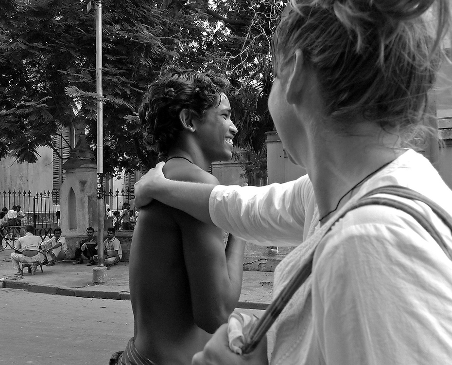 It is not acceptable for a woman to embrace a man in public.  Leah last saw Manoj when he was seven-years-old and she can barely resist throwing her arms around him.