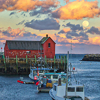 New England photography of the famous red fishing shack Motif Number One in Rockport, MA on Cape Ann with a full moon rising was photographed on a cold night. The historic landmark is known throughout New England as Motif #1, so called because it is the most often painted building in America.<br /> <br /> New England photography image of the full snow moon rising over Rockport Harbor and Motif #1 is available as museum quality photography prints, canvas prints, acrylic prints, wood prints or metal prints. Prints may be framed and matted to the individual liking and decorating needs: <br /> <br /> https://juergen-roth.pixels.com/featured/full-moon-over-motif-number-one-juergen-roth.html<br /> <br /> Good light and happy photo making!<br /> <br /> My best,<br /> <br /> Juergen<br /> Photo Prints & Licensing: http://www.rothgalleries.com<br /> Photo Blog: http://whereintheworldisjuergen.blogspot.com<br /> Instagram: https://www.instagram.com/rothgalleries<br /> Twitter: https://twitter.com/naturefineart<br /> Facebook: https://www.facebook.com
