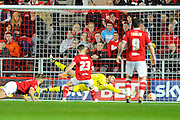 Bristol City Goalkeeper Richard O'Donnell is bearen by the shot Derby County midfielder Craig Bryson to make the scores level at 2-2 during the Sky Bet Championship match between Bristol City and Derby County at Ashton Gate, Bristol, England on 19 April 2016. Photo by Graham Hunt.