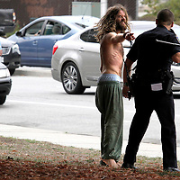 Oliver Howard, 32, gestures angrily at Santa Cruz police officer Ryan Kiar, after Kiar unsuccessfully attempted to stun Howard with his Taser during an altercation next to the Santa Cruz County Courthouse on Water Street in Santa Cruz, California on Monday October 13, 2014 as a bystander looks on.  Officer Kiar believed Howard was under the influence of narcotics and prevented him from returning to the wheel of his car after Howard initiated an interaction with Kiar while he was making an unrelated traffic stop with another motorist. The two argued while Kiar waited for backup and the situation escalated when Howard physically challenged the officer. Once backup arrived Howard was stunned and handcuffed. Howard was arrested on suspicion of resisting arrest, battery on a police officer and driving under the influence of drugs.<br />(Shmuel Thaler -- Santa Cruz Sentinel)