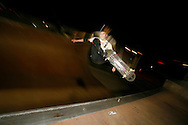 A skateboarder does a front side air on a half pipe. ..During the Santa Cruz Skateboards and Creature Skateboards team tour which made a stop at Louisville Extreme Park to film scenes for a new promotional video.
