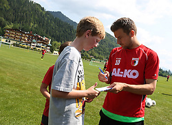 14.07.2013, Walchsee, AUT, FC Augsburg, Trainingslager, im Bild Daniel BAIER (FC Augsburg #10) schreibt Autogramme // during a trainings session of German 1st Bundesliga club FC Augsburg at their training camp in Walchsee, Austria on 2013/07/14. EXPA Pictures &copy; 2013, PhotoCredit: EXPA/ Eibner/ Klaus Rainer Krieger<br /> <br /> ***** ATTENTION - OUT OF GER *****