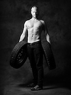 """""""I'm a student of industrial design and every one knows me as the guy who carries stuff around. Literally all the time and I like it too. I came to think of a well known photograph by Herb Ritts that my father had at home. That one portraying a shirtless masculine man that carries two heavy car tires. When I was little I thought it was kind of cool. And I figured: could that be me? Could I look awesome and beefy at the same time as I demonstrate one of my interests?""""<br /> Jens Alexandersson, 28 years"""