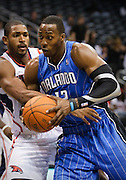 18 October 2010: Orlando's Dwight Howard (right) is being defended by Atlanta's Al Horford in Atlanta Hawks 102-73 preseason loss to the Orlando Magic at Philips Arena in Atlanta, GA.