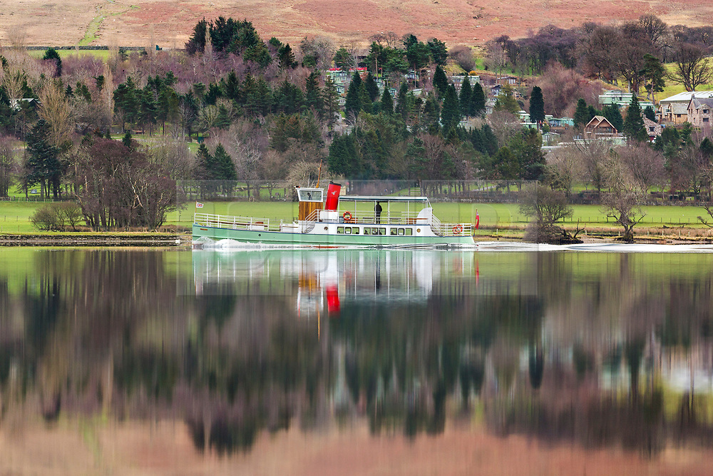 © Licensed to London News Pictures. 02/01/2019. Pooley Bridge UK. The 1935 Ullswater Steamer, Western Belle, glides through the calm water of Ullswater lake near Pooley Bridge in Cumbria this morning. Photo credit: Andrew McCaren/LNP