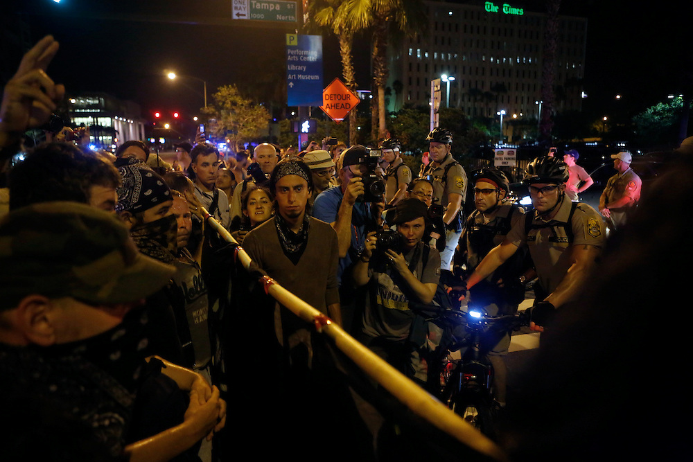 Protesters face off with law enforcement in an unscheduled silent march against police brutality during the 2012 Republican National Convention on August 29, 2012.