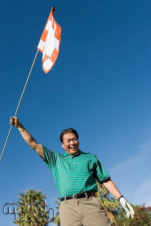Golfer Waving Golf Flag
