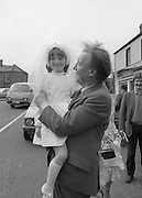 Taoiseach's Election Campaign.      (N77)..1981..23.05.1981..05.23.1981..23rd May 1981..On the 21st May the Taoiseach, Mr Charles Haughey, dissolved the Dáil and called a general election. Charles Haughey, Garret Fitzgerald and Frank Cluskey were leading their respective parties into a general election for the first time as they had only taken party leadership during the last Dáil..Fianna Fáil had hoped to call the election earlier, but the Stardust Tragedy caused the decision to be deferred...Never one to miss a photo opportunity on the campaign trail, Charles Haughey is pictured holding 7 year old Nuala O'Donnell, Esker Lawn, Lucan as he hits the campaign trail in Lucan,Co Dublin.
