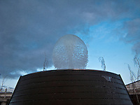 One of the fountains at the Bremerton Harborside Fountain Park erupting/spouting a ball of water, Bremerton, WA, USA.