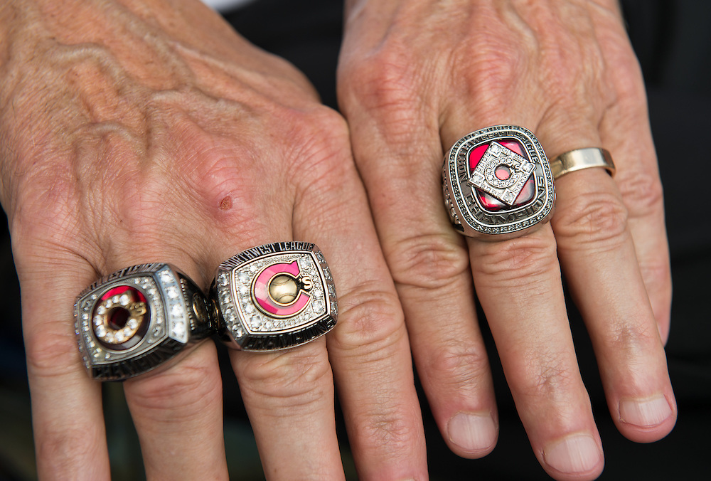 Co-owner of the Vancouver Canadians, Jeff Mooney, shows off his three North-West League championship rings before the start of the game between the Vancouver Canadians and the Everett Aquasox at Nat Bailey Stadium.