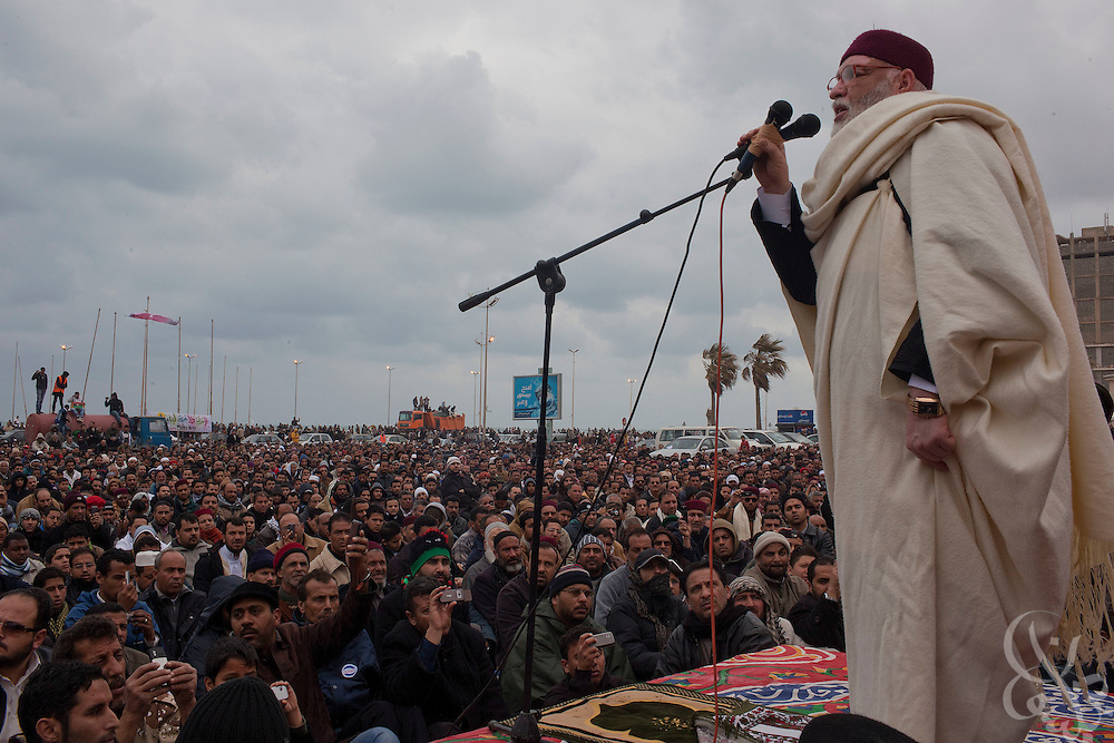 A Libyan cleric speaks to protesters during Friday prayers February 25, 2011 in the central square of Benghazi, Libya. A crowd of at least 5,000 attended the prayers and post-prayer protest, which also included funeral prayers for three victims of the recent revolution that were laid to rest today. .Slug: Libya.Credit: Scott Nelson for the New York Times