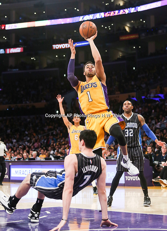 Los Angeles Lakers guard D'Angelo Russell (1) in actions during the second half of an NBA basketball game against Orlando Magic Tuesday, March 8, 2016, in Los Angeles.  Lakers won 107-98. (AP Photo/Ringo H.W. Chiu)
