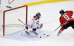 Jan 22, 2010; Newark, NJ, USA; New Jersey Devils left wing Zach Parise (9) scores a goal on Montreal Canadiens goalie Jaroslav Halak (41) during the first period at the Prudential Center.