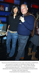 Musician DAVE GILMOUR and his wife writer POLLY SAMPSON, at a party in London on 3rd March 2004.PSE 35