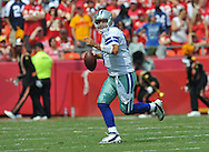 KANSAS CITY, MO - SEPTEMBER 15:  Quarterback Tony Romo #9  of the Dallas Cowboys rolls to the outside against the Kansas City Chiefs during the first half on September 15, 2013 at Arrowhead Stadium in Kansas City, Missouri.  (Photo by Peter Aiken/Getty Images) *** Local Caption *** Tony Romo