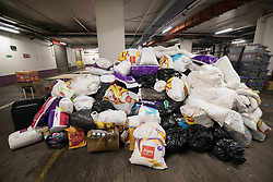 © Licensed to London News Pictures . 17/06/2017 . London, UK . Piles of donated goods for the victims of the Grenfell Tower fire , stored in a car park beneath Kensington and Chelsea Town Hall . People have been donating blankets, toys, clothes, buggies and other essentials, following a catastrophic fire that killed dozens in their homes when it engulfed and destroyed the Grenfell Tower block . Grenfell Action Group and Radical Housing Network called the protest after many accused the local council and government of failing to act to provide sufficient support before and in the wake of the fire . Photo credit: Joel Goodman/LNP
