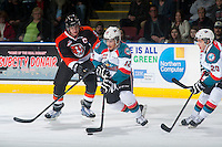 KELOWNA, CANADA - JANUARY 10: Tyler Lewington #5 of Medicine Hat Tigers checks Tyrell Goulbourne #12 of Kelowna Rockets as he skates with the puck on January 10, 2015 at Prospera Place in Kelowna, British Columbia, Canada.  (Photo by Marissa Baecker/Shoot the Breeze)  *** Local Caption *** Tyrell Goulbourne; Tyler Lewington;