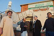 (left to right) Najib Bhudal and Niaz Ahmed, trustees of Birmingham Central Mosque, are standing in front of the mosque next to Paul Salahuddin Armstrong, co-director of The Association of British Muslims and Mohammed Abbasi of Football for Peace.