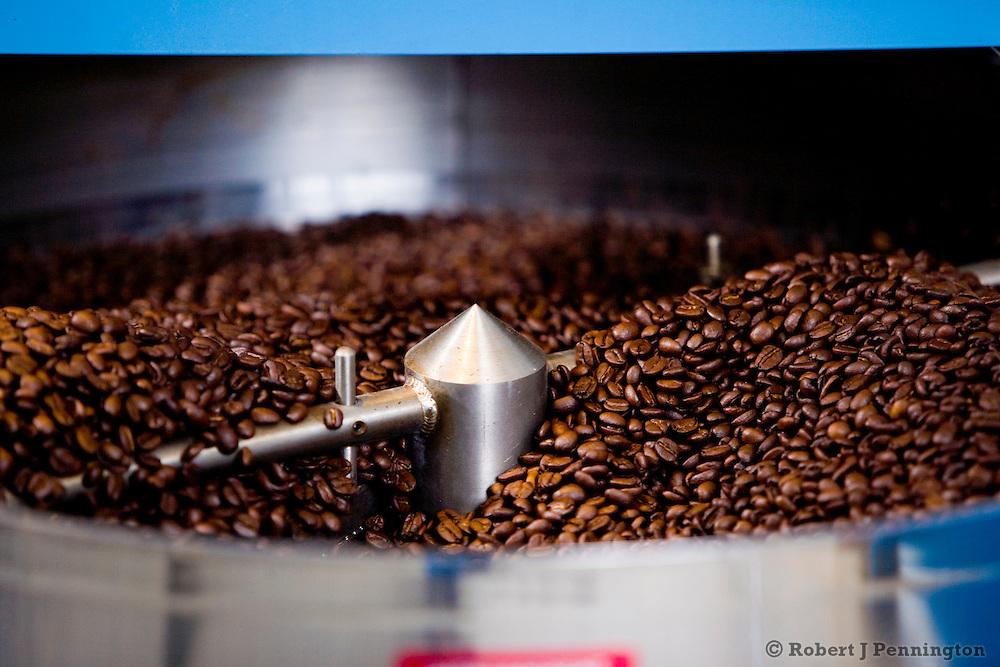 Hot freshly roasted coffee beans are cooled before packaging for sale.