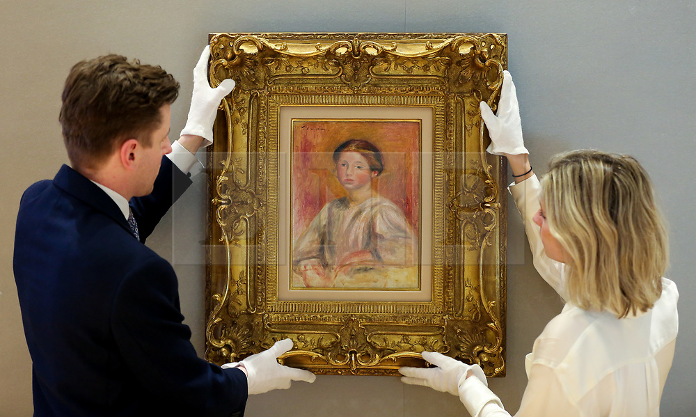 © Licensed to London News Pictures. 25/02/2019. London, UK. Technicians hang Buste de femme by Pierre-Auguste Renoir (1841-1919). Painted in 1911, it has an estimate of £300,000-500,000<br /> Bonhams Impressionist and Modern Art Sale will take place in London on 28 February 2019. Photo credit: Dinendra Haria/LNP