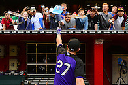 Apr 29, 2016; Phoenix, AZ, USA; Colorado Rockies shortstop Trevor Story (27) signs a bat for a fan prior to the game against the Arizona Diamondbacks at Chase Field. Mandatory Credit: Jennifer Stewart-USA TODAY Sports