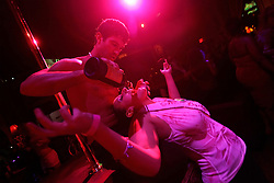 A patron drinks during a striptease show, Thursday, October 5, 2006 in New York.