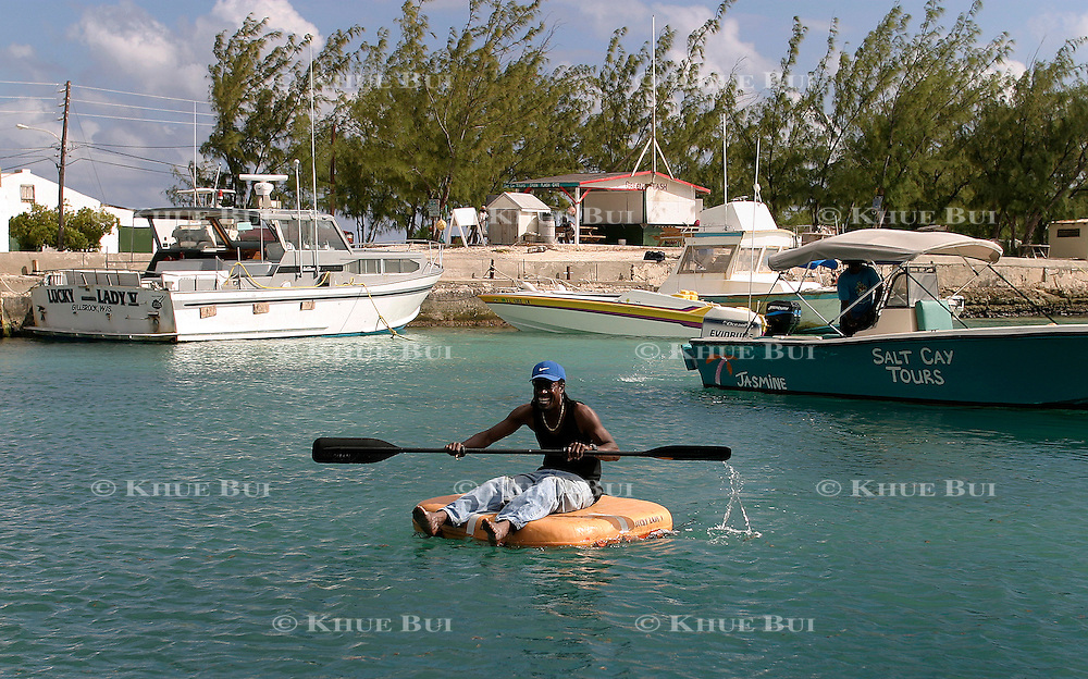 Local playing around Sunday, February 22, 2004, in Salt Cay, Turks and Caicos...Photo by Khue Bui