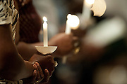 Visitors hold candles during a memorial service for Ebola patient Thomas Eric Duncan at Wilshire Baptist Church on October 8, 2014, in Dallas. (Cooper Neill for The New York Times)