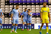 Coventry City celebrate the wining goal by Coventry City midfielder Liam Walsh (20), on loan from Bristol City, to make the score 2-1 during the EFL Sky Bet League 1 match between Coventry City and AFC Wimbledon at the Trillion Trophy Stadium, Birmingham, England on 17 September 2019.