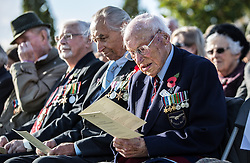 "Surviving ""Guinea pig club"" member Des O'Connell sits with other survivors as he waits for the ceremony to unveil a new memorial to those airmen saved after being burned in their aircraft at the National Memorial Arboretum, Staffordshire."
