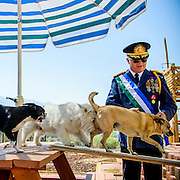 Photo by Matt Roth<br /> <br /> All the Molossian dogs are citizens of the micronation.<br /> <br /> The Republic of Molossia is a tiny micronation run by fifty-one-year-old President Kevin Baugh an his family. The micronation is surrounded by Dayton, Nevada. <br /> <br /> Monday, August 12, 2013 XXXVI