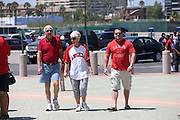 ANAHEIM, CA - JUNE 16:  A son and his father and mother enter the stadium before the Los Angeles Angels of Anaheim game against the New York Yankees on Sunday, June 16, 2013 at Angel Stadium in Anaheim, California. The Yankees won the game 6-5. (Photo by Paul Spinelli/MLB Photos via Getty Images)