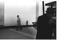 Man eating sandwich, Street photography. 1980
