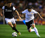 VALENCIA, SPAIN - APRIL 20: (R) Ever Banega of Valencia CF  is followed by (L) Ignacio Camacho of Malaga CF during the Liga BBVA between Valencia CF and Malaga CF at the Mestalla stadium on April 20, 2013 in Valencia, Spain. (Photo by Aitor Alcalde Colomer).