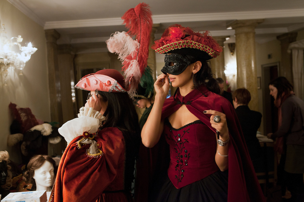 Women try a mask during the carnival in Venice.