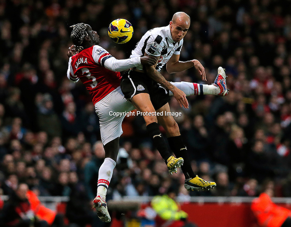 Bacary Sagna of Arsenal (L) vies for ball with Gabriel Obertan of Newcastle United (R) during the English Premier League soccer match between Arsenal and Newcastle United at the Emirates Stadium, London, Britain, on 29 December 2012.  EPA/KERIM OKTEN DataCo terms and conditions apply. http//www.epa.eu/downloads/DataCo-TCs.pdf