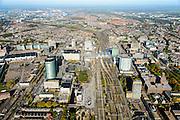 Nederland, Utrecht, Utrecht, 24-10-2013;<br /> Overzicht stad stationsgebied Centraal Station met nieuwe overkapping en Hoog Catherijne. Hoofdkantoor van de RABO-bank, de dubbele toren van groen glas, de Rabotoren (architect:  Rob Ligtvoet van Kraaijvanger Urbis), bijnaam de verrekijker. Zicht op binnenstad  in NW richting.<br /> Overview city station area Central Station Utrecht with new roof and Hoog Catherijne. Headquarters of the Rabobank, the double tower of green glass, the Rabotoren (architect:  Rob Ligtvoet of Kraaijvanger Urbis), nicknamed the binoculars. View on town centre direction NW.<br /> luchtfoto (toeslag op standaard tarieven);<br /> aerial photo (additional fee required);<br /> copyright foto/photo Siebe Swart.
