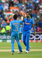 Cricket - 2019 ICC Cricket World Cup - Group Stage: Bangladesh vs. India<br /> <br /> India's Yuzvendra Chahal congratulates India's Bhuvneshwar Kumar as Bangladesh's Mashrafe Mortaza is caught by MS Dhoni for 8, at Edgbaston<br /> <br /> COLORSPORT/ASHLEY WESTERN