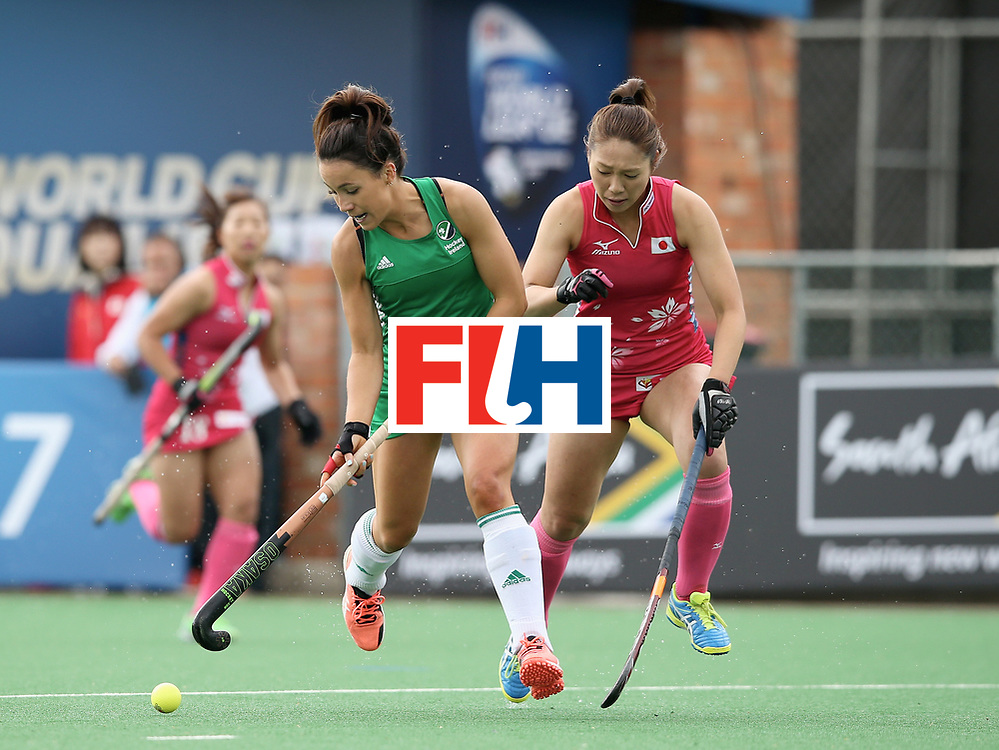 JOHANNESBURG, SOUTH AFRICA - JULY 8: Anna O'Flanagan of Ireland and Mami Ichitani of Japan battle for possession during the pool A match between Japan and Ireland on day one of the FIH Hockey World League Semi-Final at Wits University on July 8, 2017 in Johannesburg, South Africa. (Photo by Jan Kruger/Getty Images for FIH)