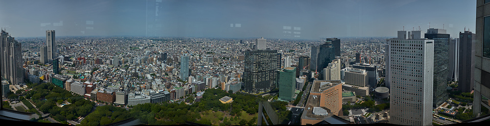 Panoramic View (270 degrees) of the Tokyo Skyline from the 47th floor North Tower Observatory in the Metropolitan Government Building. Composite of 42 images taken with a Leica CL camera and 18 mm f/2.8 lens (ISO 100, 18 mm, f/2.8, 1/2000 sec). Raw images processed with Capture One Pro and AutoPano Giga Pro.