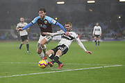 Fulham defender Maxime Le Marchand (20) challenges 13 Jeff Hendrick for Burnley FC during the Premier League match between Burnley and Fulham at Turf Moor, Burnley, England on 12 January 2019.