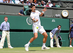 Image licensed to i-Images Picture Agency. 27/06/2014. London, United Kingdom. Novak Djokovic in action against Gilles Simon  on day five of the Wimbledon Tennis Championships . Picture by Stephen Lock / i-Images