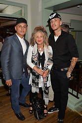 Left to right, STUART WATTS, ELIZABETH EMANUEL and Rapper ECKSELL at the 50th anniversary party for Daphne's restaurant, 112 Draycott Avenue, London held on 24th June 2014.